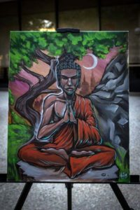 Thomas Lucero painted this painting of Budda for the Visions of Words event.